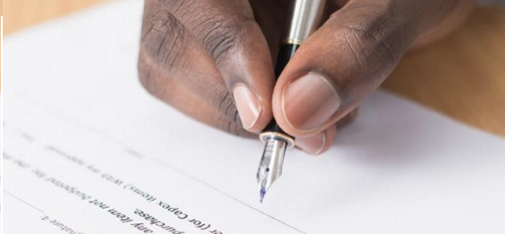 Person signing a legal document