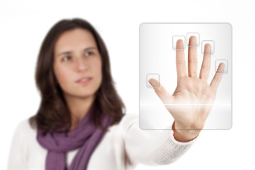 Access control - person having fingerprints scanned for security