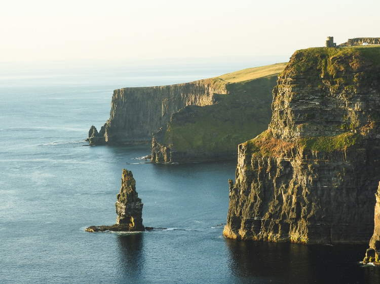 Irish coastline, with very vlue ocean and green cliffs and rocks.